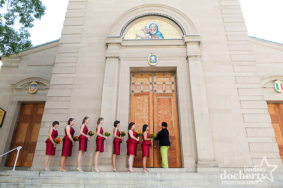 bridesmaids waiting in line before wedding ceremony in Holy Rosary Catholic Church