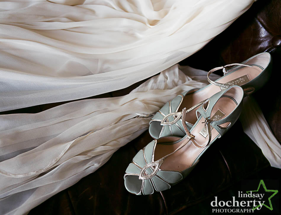closeup wedding dress and blue shoes at hotel Palomar in Philadelphia