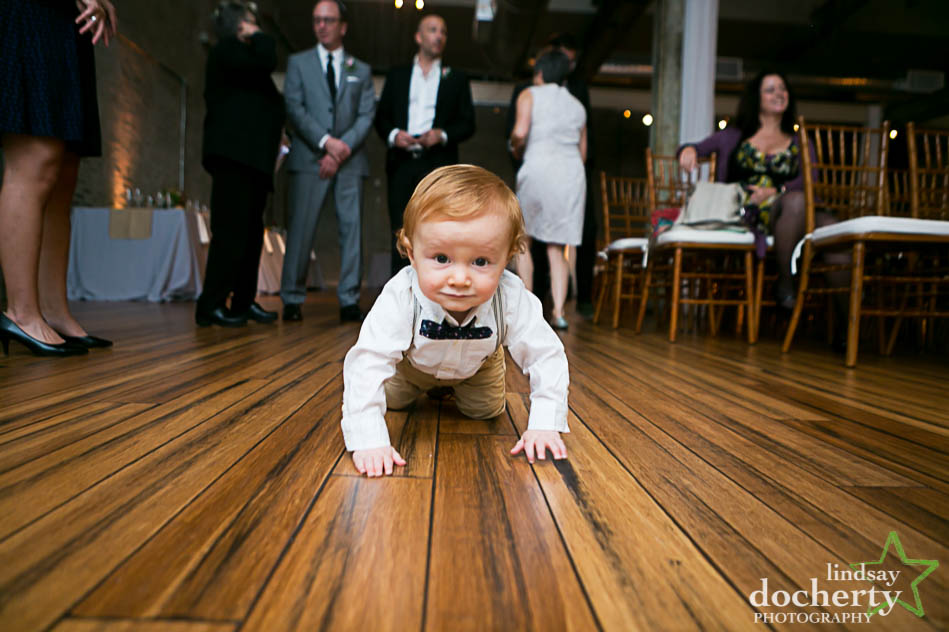 crawling babyin a bowtie at Philadelphia wedding at Front and Palmer