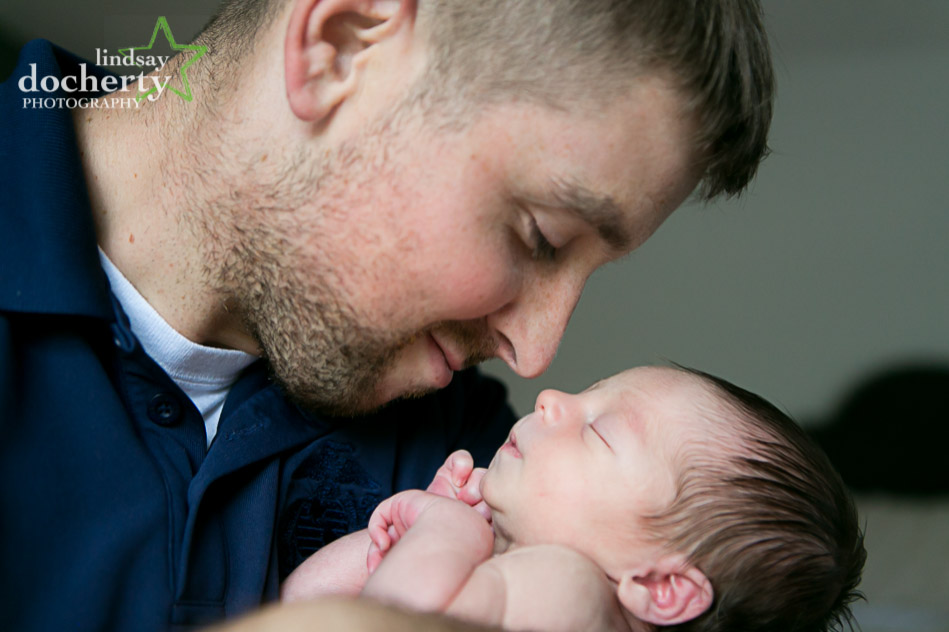 daddy and infant nose to nose at newborn photoshoot