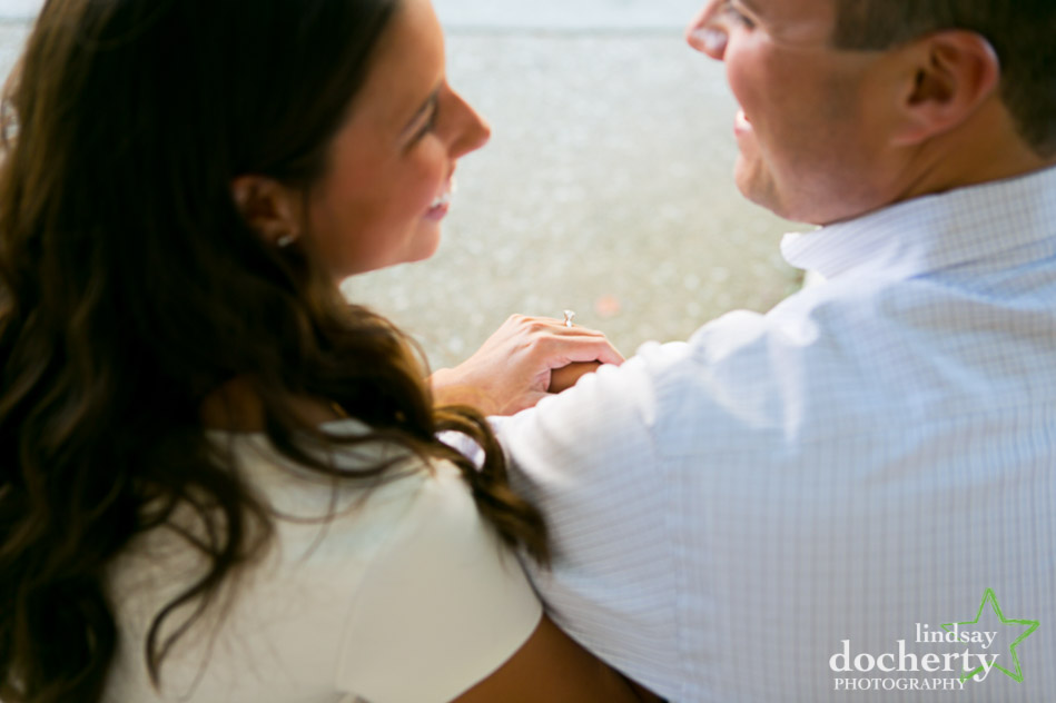 engagement ring and couple during engagement photo session