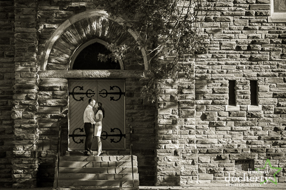 engagement session in front of old stone building in Conshohocken