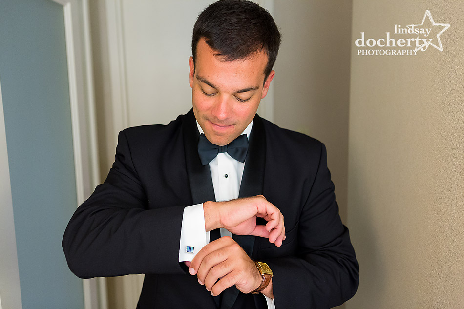 groom putting on cufflinks the morning of the wedding