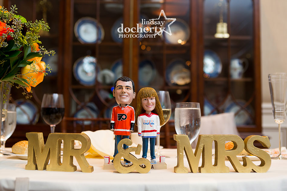 Flyers and Capitals bobblehead figurines at DC hockey-themed wedding