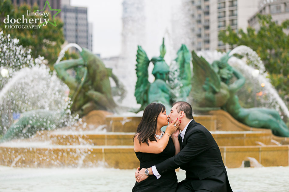 kissing pictures at engagement session at Logan Square fountain