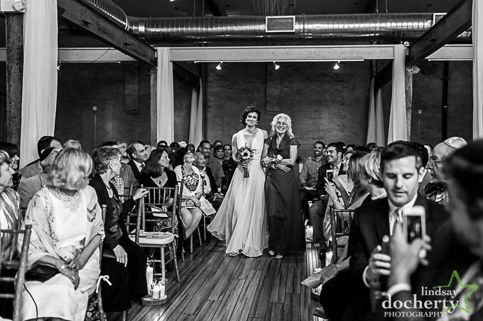 mother and bride walk down aisle in wedding at Front and Palmer