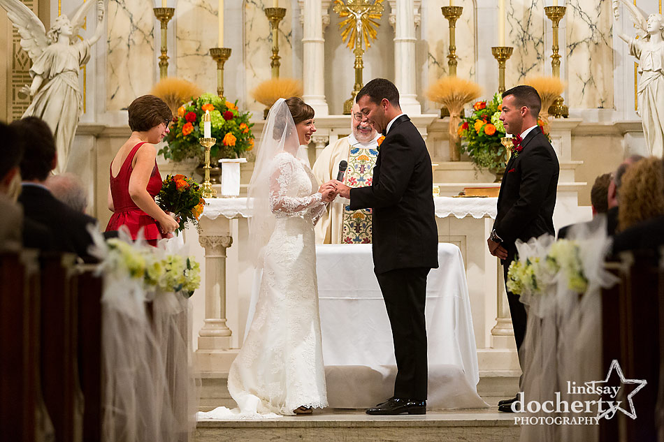 wedding ring excahnge at ceremony in Holy Rosary Catholic Church