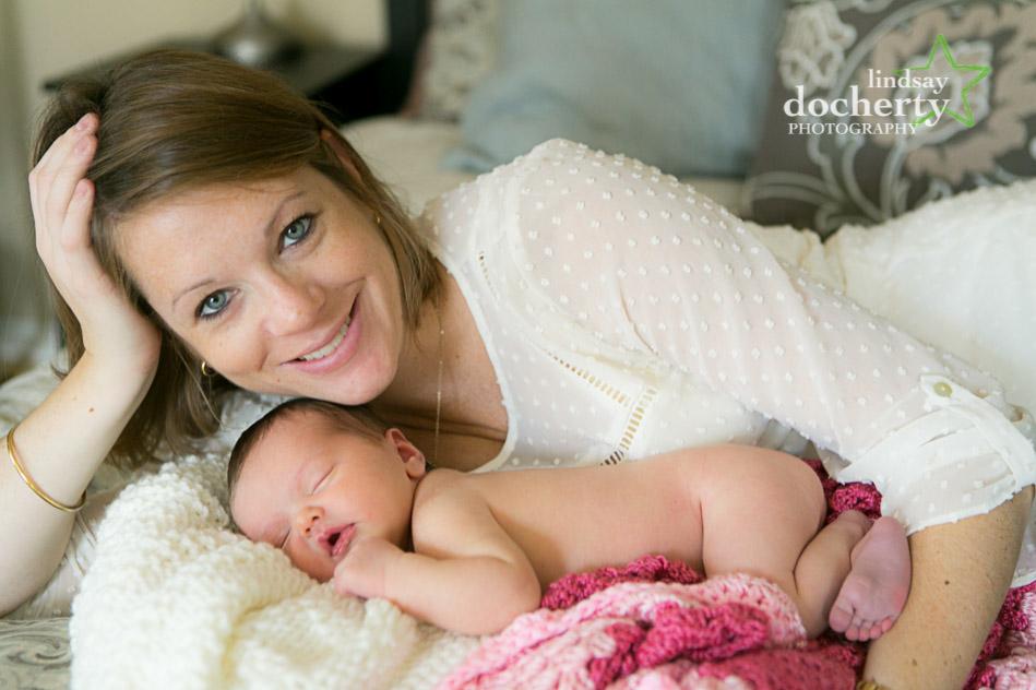 sweet sleeping baby girl with mom