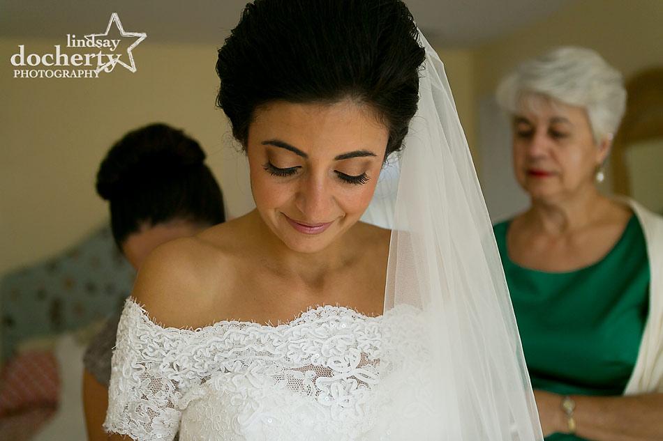 Greek bride getting ready for wedding day at backyard wedding on Shelter Island, New York