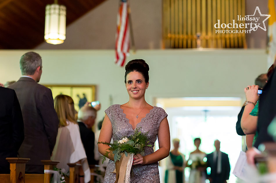 maid of honor during Catholic wedding ceremony at Our Lady of the Isle Church on Shelter Island, NY