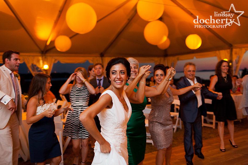Greek wedding dancing at wedding reception at tent wedding on Shelter Island in New York