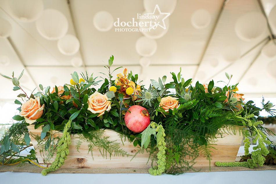 peach, yellow, and pomegranate centerpiece at tent wedding on Shelter Island in New York