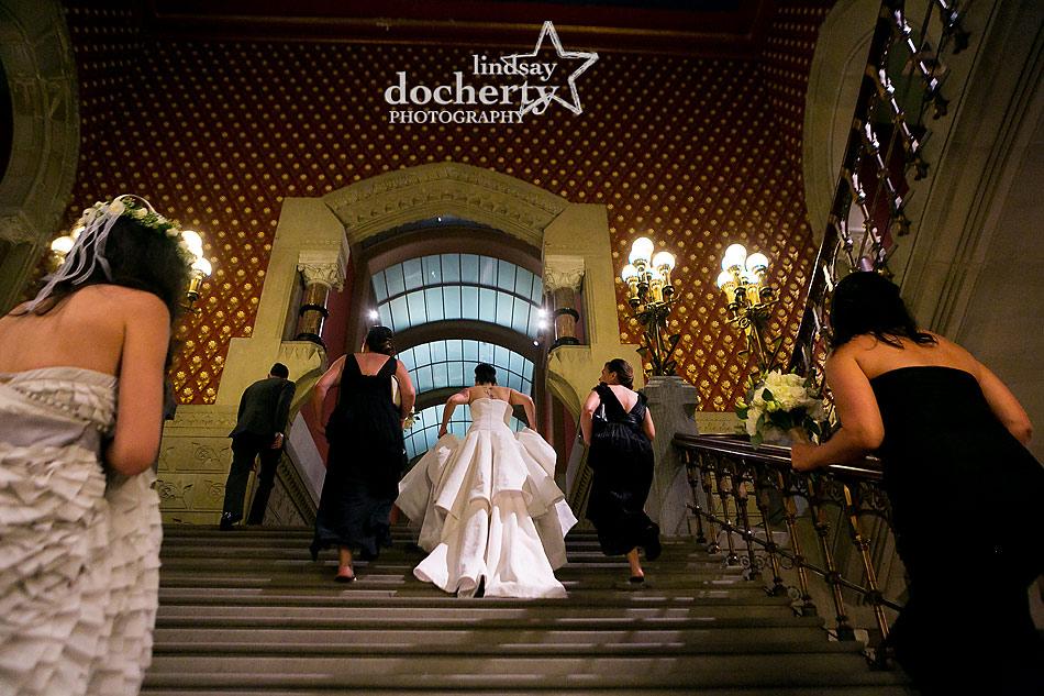 bridesmaids walking up PAFA stairs at Philadelphia wedding