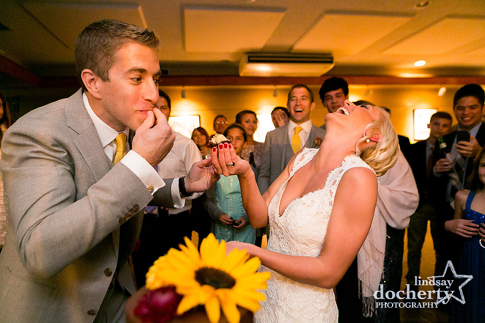 bride-and-groom-cake-cutting-at-fall-wedding-at-Tyler-Arboretum