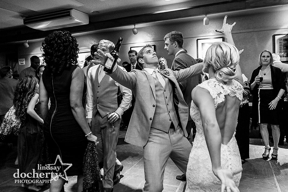 bride-and-groom-rocking-out-dancing-at-wedding-reception