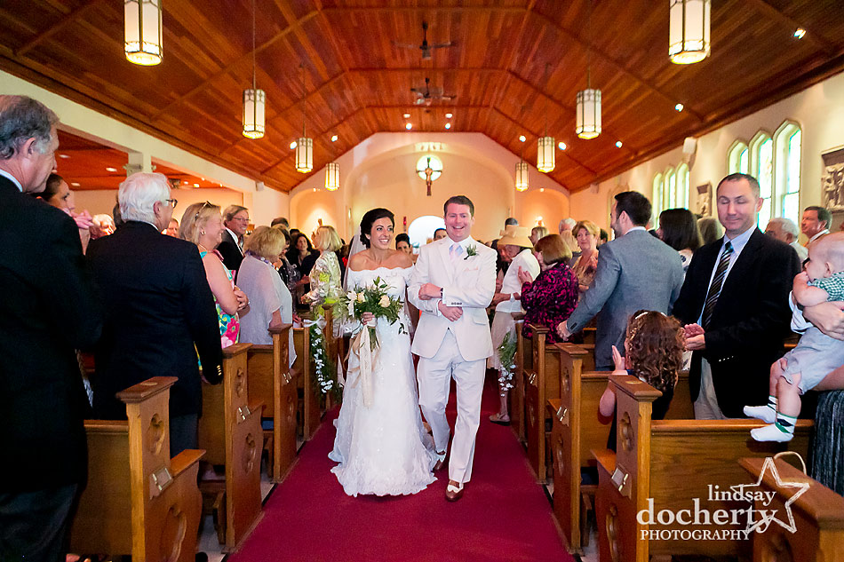 bride and groom during Catholic wedding ceremony at Our Lady of the Isle Church on Shelter Island, NY