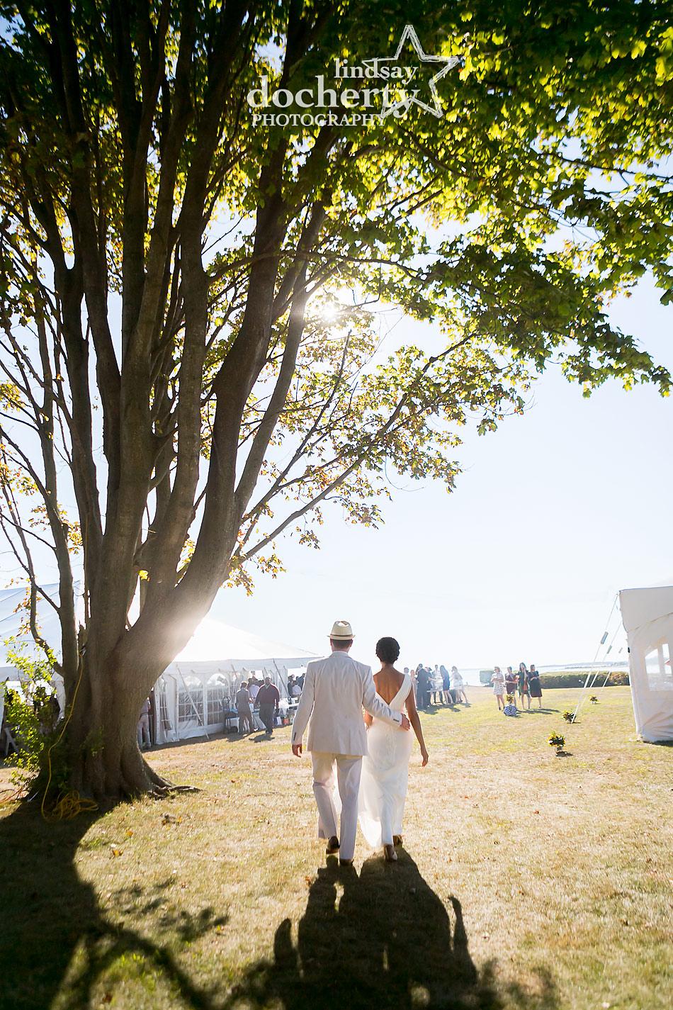 bride and groom walking into backyard wedding on Shelter Island in New York