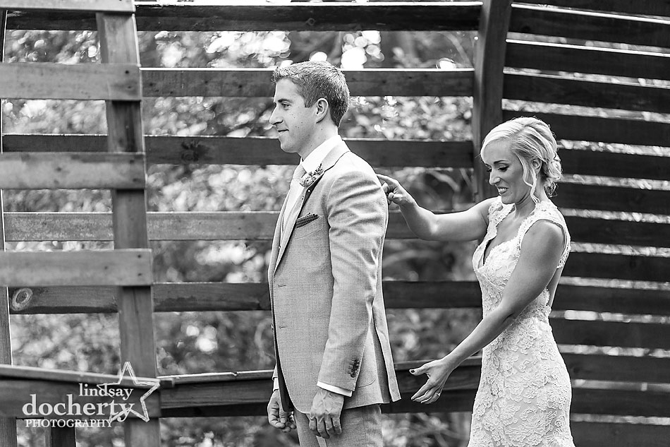 bride-grabs-grooms-butt-at-fall-wedding-at-Tyler-Arboretum