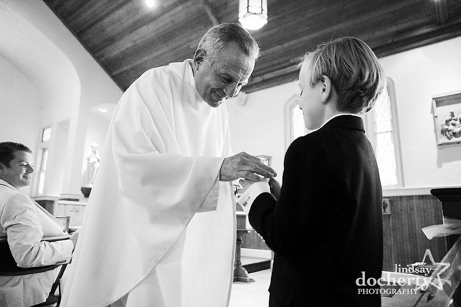 little boy during Catholic wedding ceremony at Our Lady of the Isle Church on Shelter Island, NY