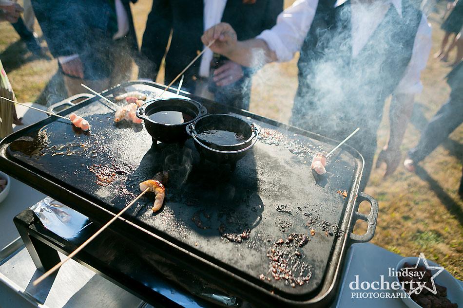 shrimp grilling station at backyard wedding on Shelter Island in New York