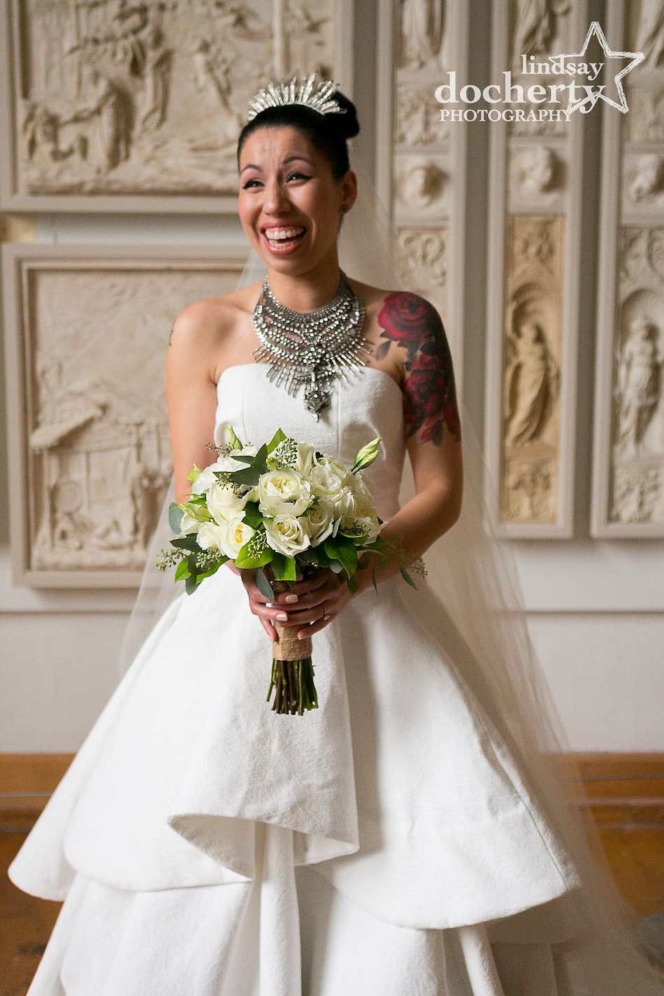 Alternative tattooed bride with tiara, statement necklace, and white bouquet at PAFA wedding in Philadelphia
