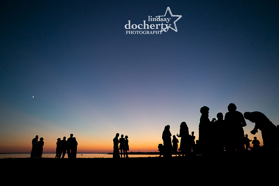 guests at sunset at backyard wedding on Shelter Island in New York
