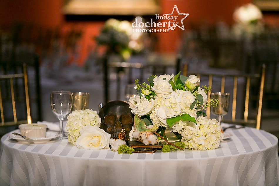 sweetheart reception table with skull, white flowers, butterflies, and books at PAFA wedding in Philadelphia