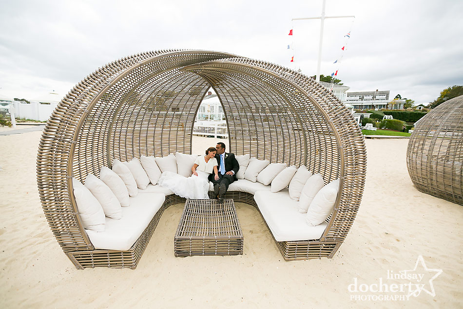 bride-and-groom-in-wicker-pod-at-Chatham-Bars-Inn-wedding-on-Cape-Cod