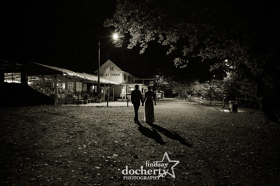 bride-and-groom-walking-into-reception-at-fall-Valley-Green-Inn-wedding-in-Philadelphia