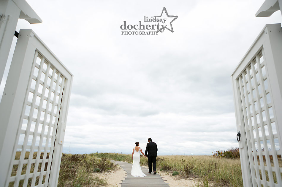 bride-and-groom-walking-onto-beach-at-Chatham-Bars-Inn-wedding-in-Cape-Cod