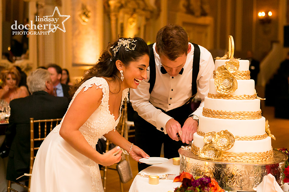 bride-laughing-while-cutting-cake-at-hotel-dupont-wedding