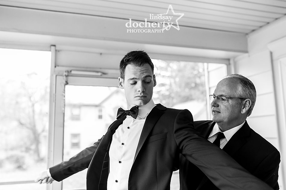 groom-getting-ready-with-father-before-wedding-ceremony
