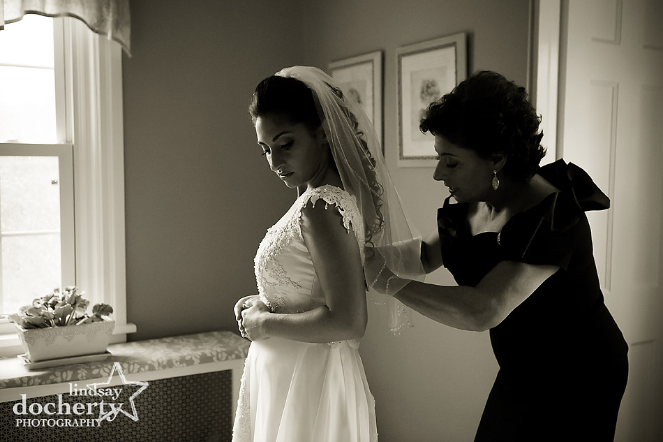 mother-helping-bride-get-ready-on-wedding-day