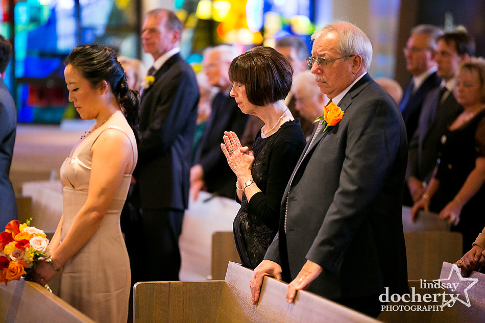 mother-of-bride-praying-during-wedding-ceremony
