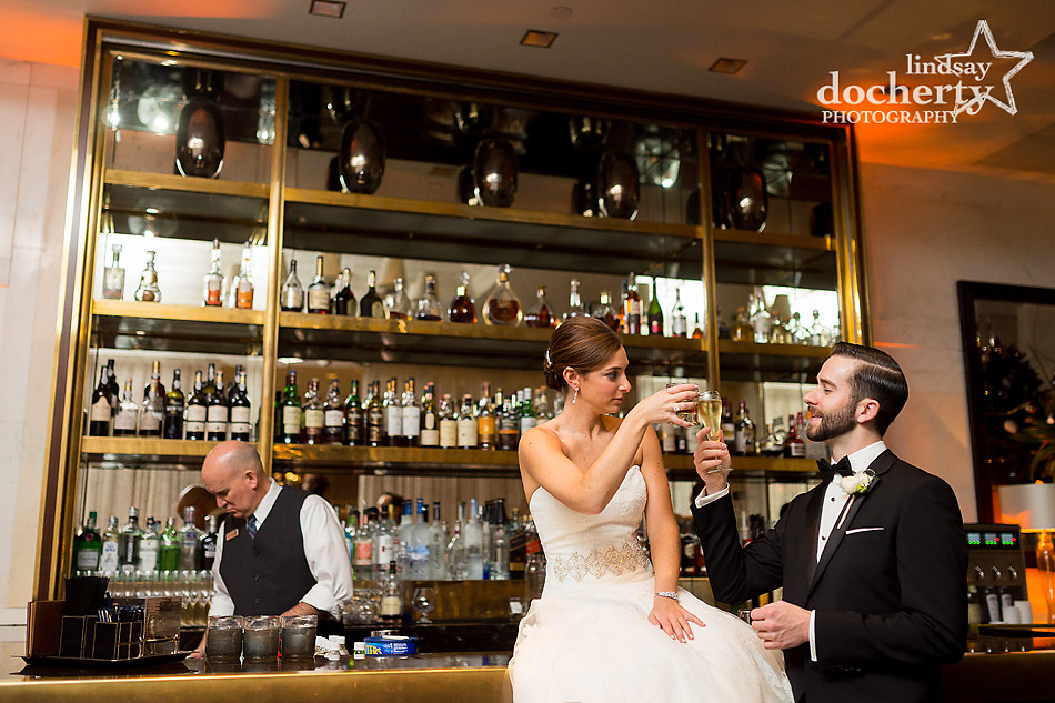 bride-and-groom-at-bar-before-wedding-at-Union-League