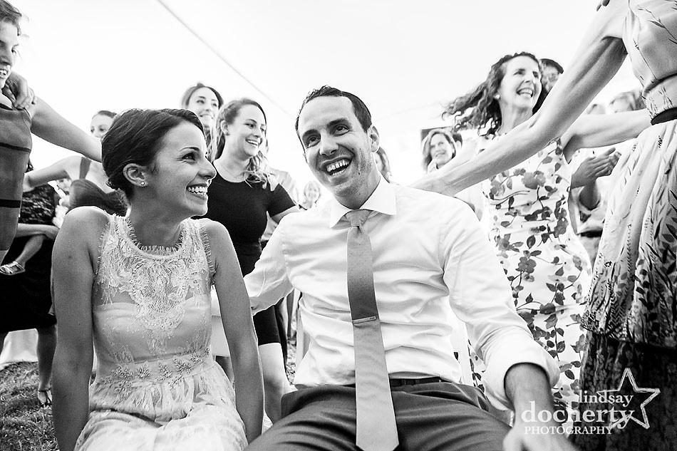 bride-and-groom-circled-at-hora-at-wedding-reception