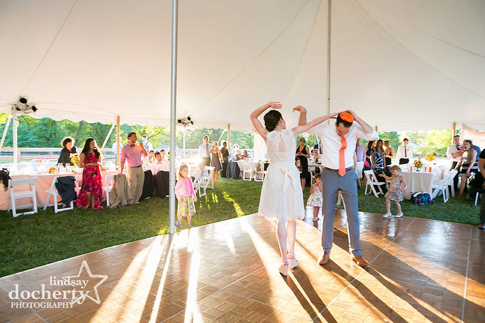 bride-and-groom-first-dance-in-tented-wedding-reception