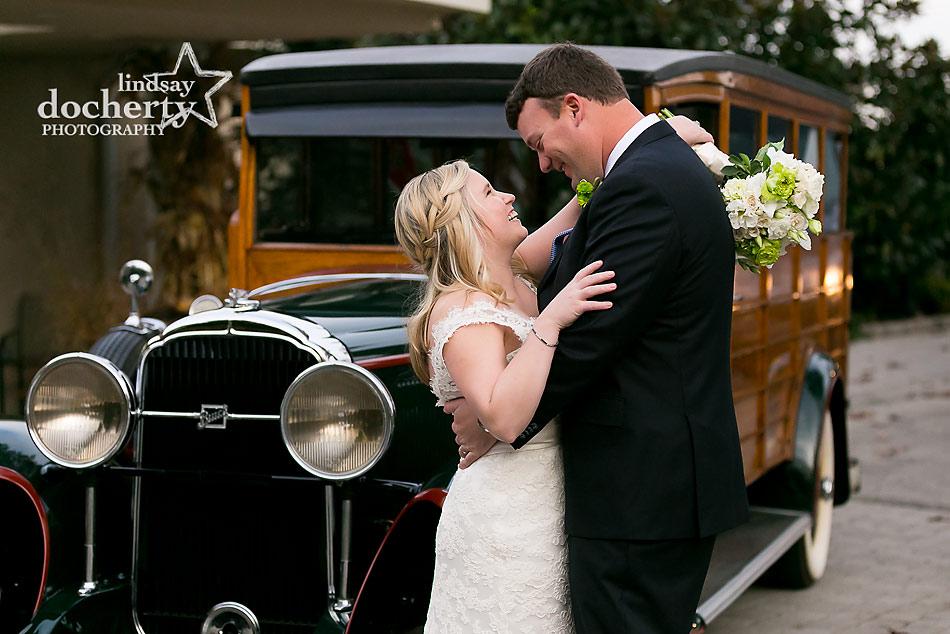 bride-and-groom-in-front-of-vintage-Woodie