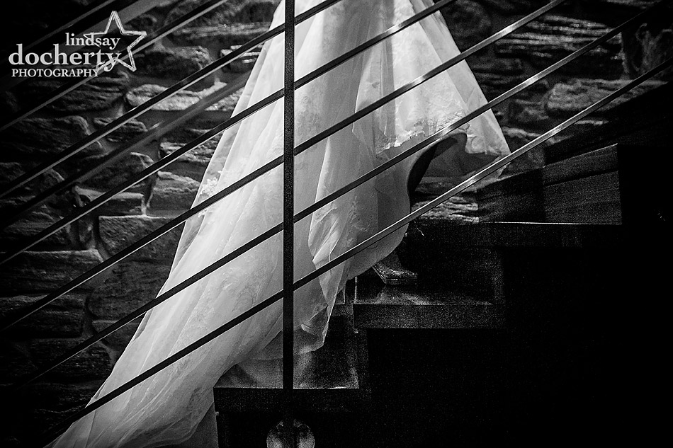 bride-dress-and-shoes-details-on-stairs-at-Union-League-wedding-in-Philadelphia