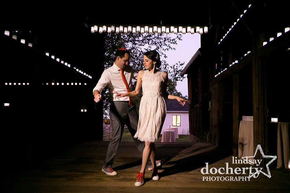 bride-in-short-wedding-dress-dancing-with-groom-in-barn
