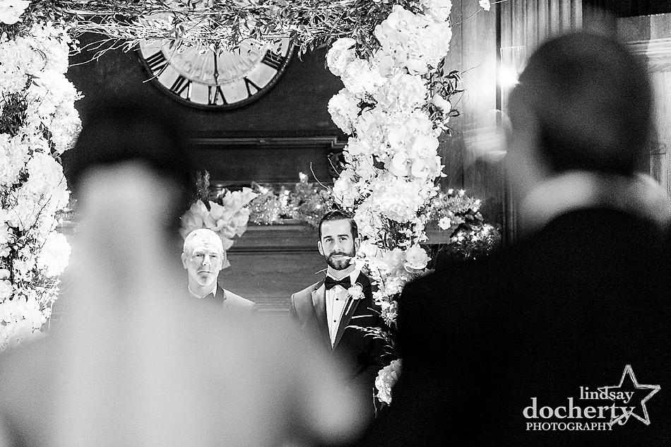 bride-walking-down-aisle-to-groom-at-Union-League-wedding-in-Philadelphia