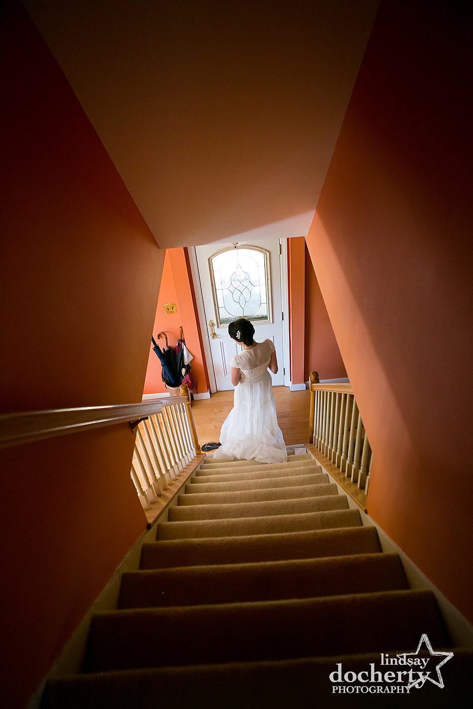 bride-walking-down-stairs-on-morning-of-wedding