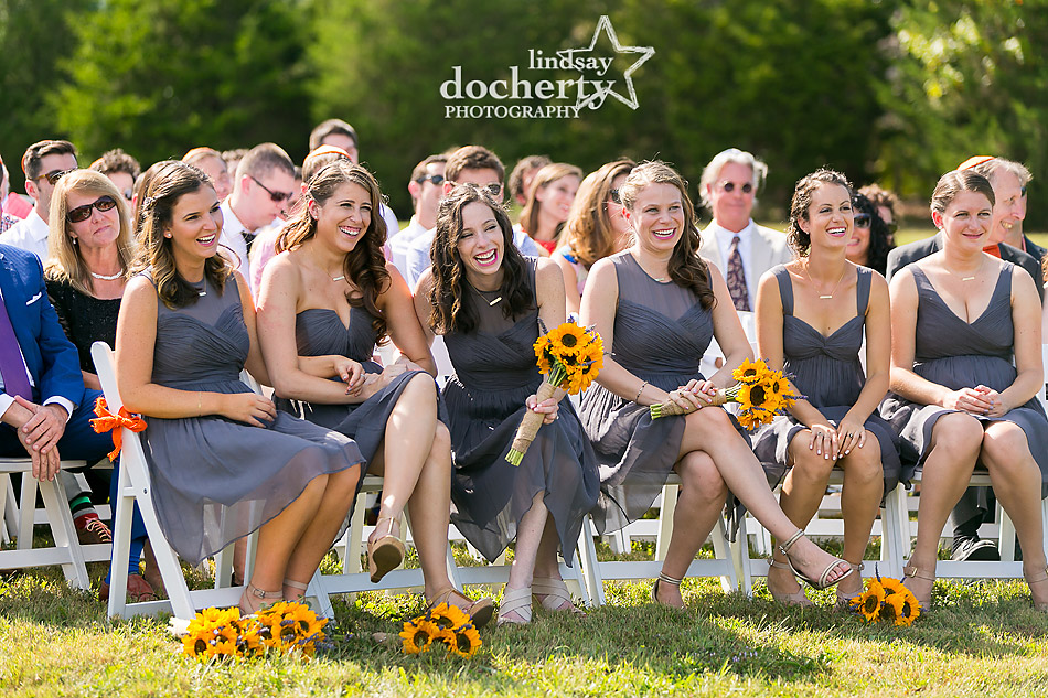 bridesmaids-in-grey-watching-Jewish-wedding-ceremony