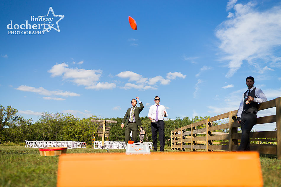 cornhole-lawn-games-at-summer-Bucks-County-farm-wedding