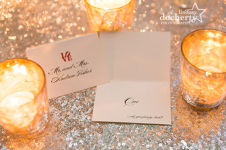 escort-cards-for-bride-and-groom-on-sequin-linens