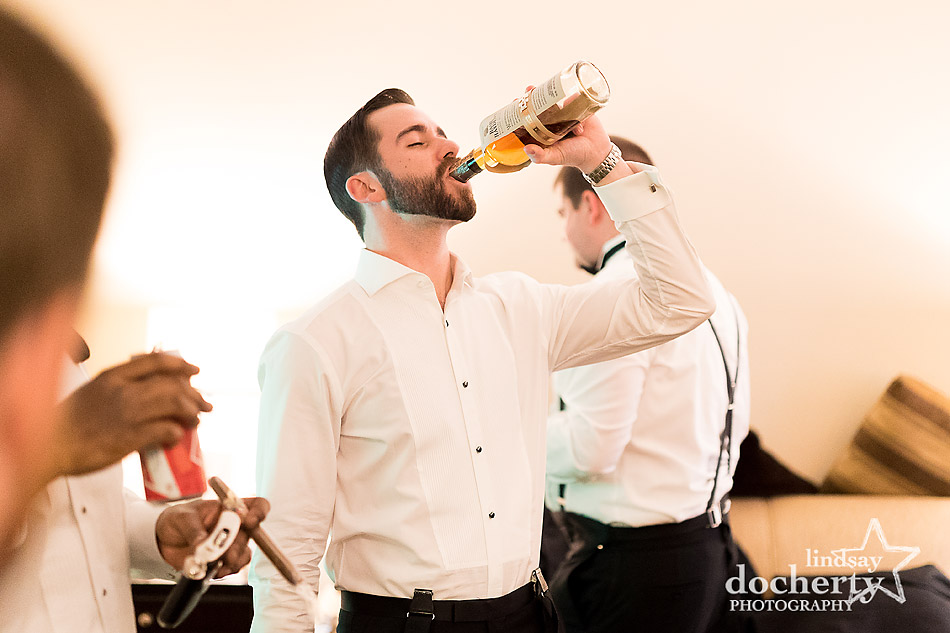 groom-drinking-before-Union-League-wedding-in-Philadelphia