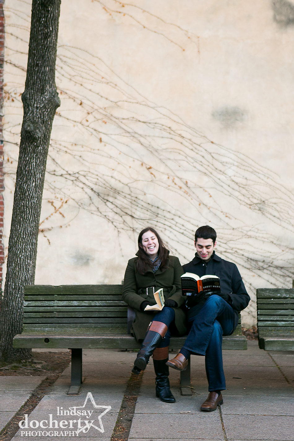 reading-together-at-engagement-session-in-Philadelphia