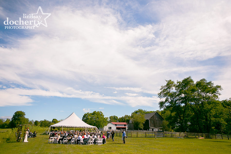 wedding-ceremony-on-farm-with-tent-in-Bucks-County