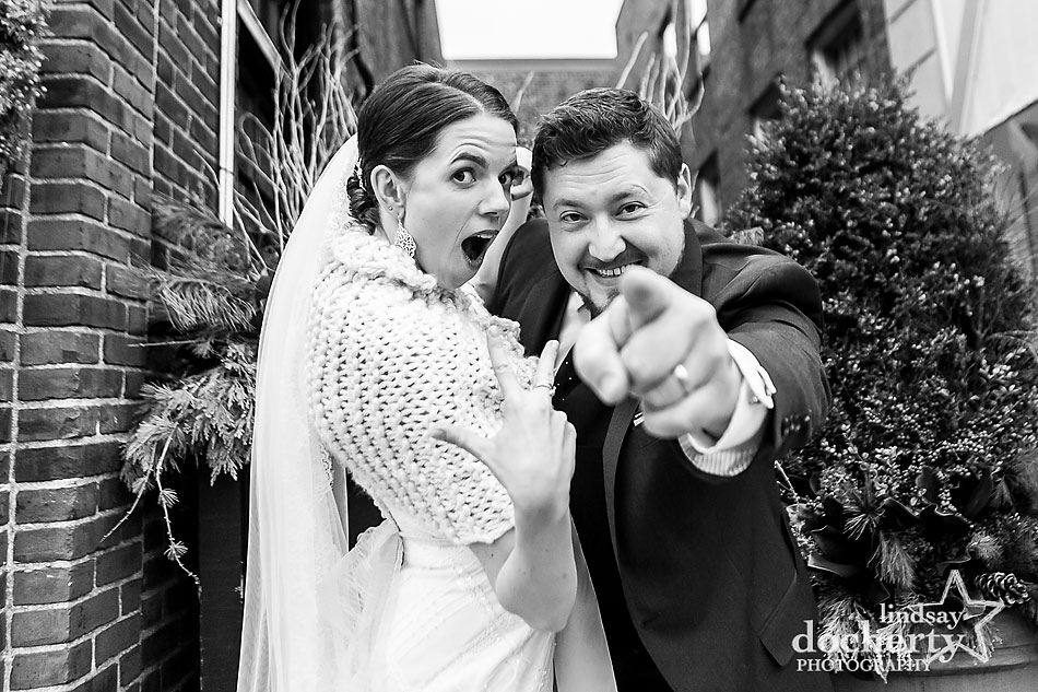 bride-and-groom-throwing-gang-signs-on-wedding-day