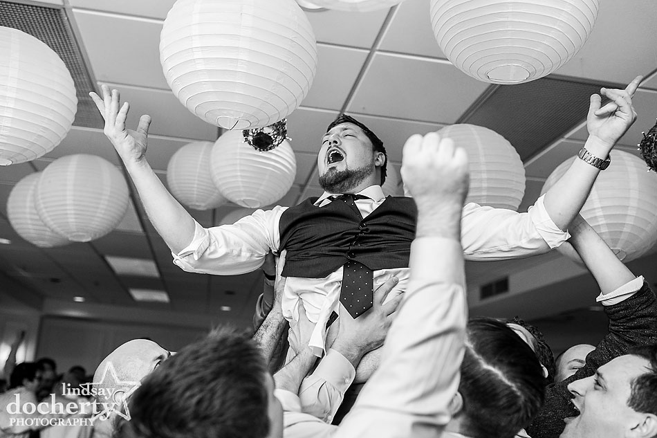 groom-lifted-during-reception--at-Main-Line-wedding-at-Peoples-Light-and-Theater
